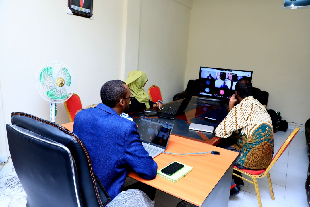 Mukhtar Abdi Omar, Dean, School of Postgraduate Studies and Research (SPGSR), Amoud University (foreground), Saida Abdirahman Omar, Associate Dean, Borama Campus, AUSPGSR(far left) and Zakariye Mohamed Ahmed, Assistant Dean, Borama Campus, AUSPGSR (right), following a live session on a monitor during the online Research Proposal Viva Voce for second year Masters Degree Students held at AUSPGSR, Borama Campus, June 2020 at the peak of covid-19 pandemic upon closure of all learning institutions by the government in order to mitigate negative effects associated with covid-19.