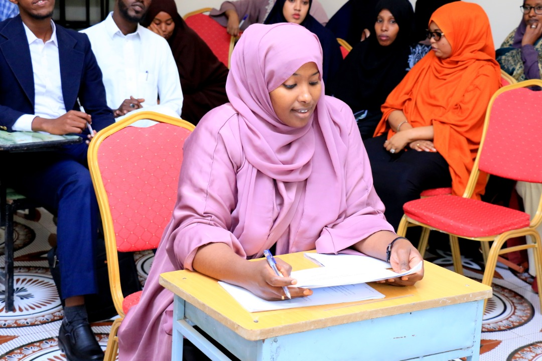 A student keenly listening to questions from the panelists, at Amoud University School of Postgraduate Studies and Research (ASPGSR), during the Research Proposal Viva Voce conducted on Monday, January 24th, 2020 at Amoud University School of Postgraduate Studies and Research (ASPGSR), Hargeisa Campus.