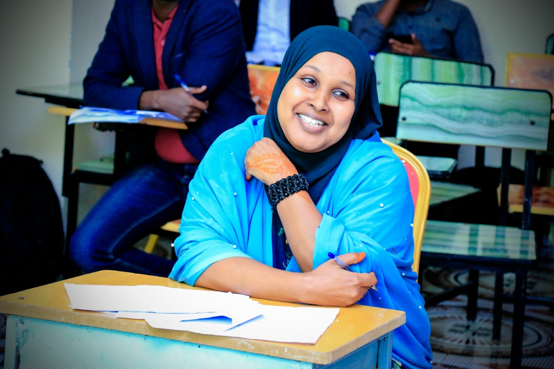 A student reacting to questions from the panelists, at Amoud University School of Postgraduate Studies and Research (ASPGSR), during the Research Proposal Viva Voce conducted On Thursday, January 24th, 2020 at Amoud University School of Postgraduate Studies and Research (ASPGSR), Hargeisa Campus premises.
