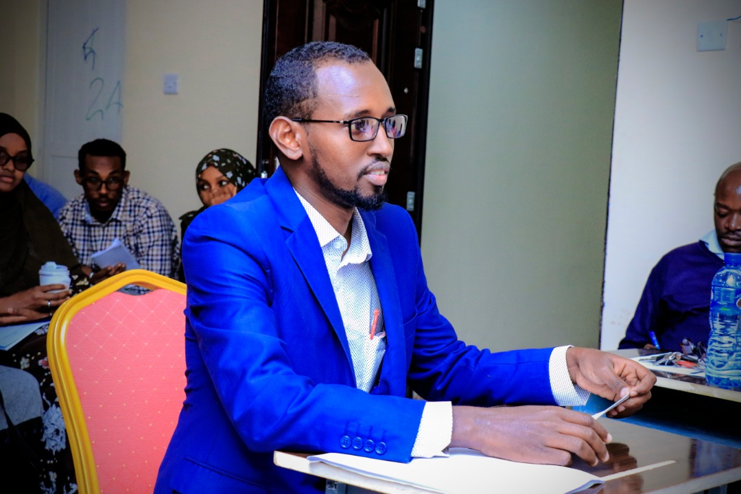 A student keenly listening to questions from the panelists, at Amoud University School of Postgraduate Studies and Research (ASPGSR), during the Research Proposal Viva Voce conducted On Thursday, January 23rd, 2020 at Amoud University School of Postgraduate Studies and Research (ASPGSR), Hargeisa Campus premises.